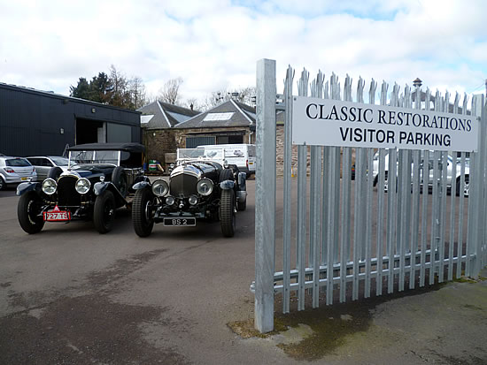 Classic Restorations carpark with vintage vehicles